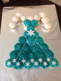 Frozen Elsa dress cupcake cake - add wand and tiara
