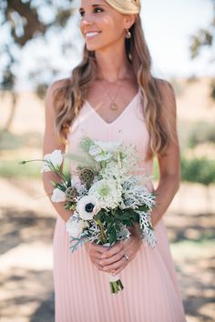 White anemone, roses, scabiosa pod, and dusty miller bridesmaid bouquet   Dennis Kwan Weddings   Brides.com