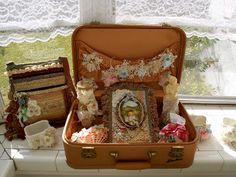 decorative suitcase filled with decor or Christmas things...in guest room.