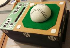 1 - box Black construction paper Green and light brown felt Sticker letters & numbers 1/2 styrofoam ball Used permanent marker to decorate softballs White construction paper for bases Green construction paper for scoreboard Approx cost between $8-$10