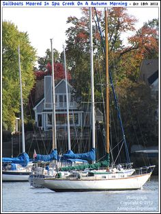 Sailboats moored in front of a couple of residences along Spa Creek in Annapolis Maryland as the shoreline foliage begins to take on its Autumn hues. Photograph posted on October 18th 2012. To see a full size version of this photograph, as well as the accompanying Annapolis Experience Blog article, please click through on the Pinterest images for it. Copyright © 2012 Annapolis Experience