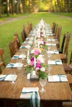 Love the old wood table and mix-and-match chairs, called to order by the place settings and continuous centerpiece.