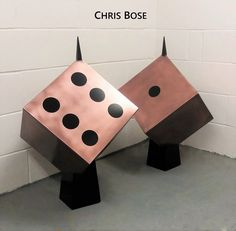 Dice garden sculpture by Chris Bose - hand-finished in copper. Private commission.