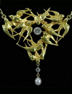 Art Nouveau 'Swallows' pendant necklace, French, 1890s. 18K gold, diamonds and natural pearl.
