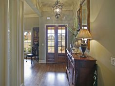 entry way, beautiful front doors, giant windows, #carpet #crown molding #piperton #dream home #magnolia home