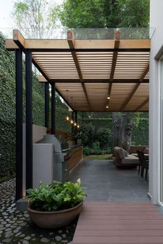 The wooden pergola is a good solution to add beauty to your garden. If you are not ready to spend thousands of dollars for building a cozy pergola then you may devise new strategies of trying out something different so that you can re Deck With Pergola, Outdoor Pergola, Backyard Pergola, Backyard Landscaping, Patio Stone, Patio Privacy, Flagstone Patio, Concrete Patio, Small Pergola