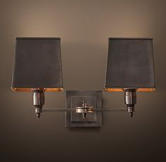 RH's Claridge Double Sconce - Bronze with Metal Shade:Elegant hotels and other well-dressed venues illuminate their spaces with lighting based on traditional lamps. Our sconce reflects this sensibility, with all-brass construction and thoroughly classic design.
