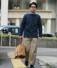 Japanese style, the wide khakis teamed up with a well buffed pair of derbies and a boat neck sweater. My ideal spring look!