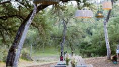 Basket Pendant Lamps    The pendant lamps are hung on tension wires, one high and one low, to achieve a random pattern above the redwood table. The lamps are outfitted with halogen bulbs outdoors that will last for years, even outside.