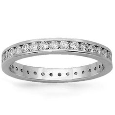 This elegant womens diamond eternity band is handcrafted in 14k white gold. Small brilliant round cut diamonds are channel set all the way across the band and total to 1.03 carats. The band measures to 2.8 inches in width and weighs 2.5 grams. $1,779.00