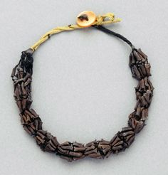 Morocco | Necklace; Spice pods, fiber and shell | African Museum (Belgium) Collection; acquired 1984 Ethnic Jewelry, Beaded Jewellery, African Museum, African Beads, Paper Beads, Morocco, Belgium, Spice, Shells
