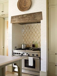 Love the wood and backsplash on the oven