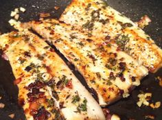 Pan Seared fish with lemon and garlic.  Sometimes I add Thyme, sometimes Rosemary, sometimes capers.  Sometimes I use butter and olive oil.  I always sear the lemon.  This is my go to fish recipe.