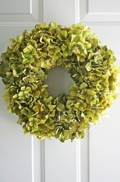 "Classic green hydrangea wreath - perfect for spring and summer!  (From ""Spring Forward with Bright and Cheerful Spring Wreaths"") #decor #ideas #flowers #beautiful UpdateDallas"