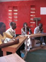 """From March, 2009: in these adult education classes, we discussed HIV/AIDS and made signs related to HIV and translated them from English to Kimaasai.    """"Don't touch human blood.  Mimbung osarge lenkae kerai.""""    """"AIDS is death.  Keeya bititia."""""""