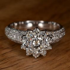RESERVED Diamond Flower Engagement Ring 18k White Gold by JdotC Looks like my ring but upgraded!!!