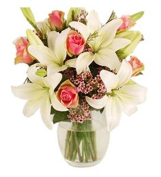 Beautiful, elegant cream lilies are arranged with the prettiest of pink roses to make this really charming bouquet. The tiny pink waxflowers, which peep out from amongst the larger blooms, complete this really sweet hand-tied bouquet that is sure to delight with its delicate beauty.