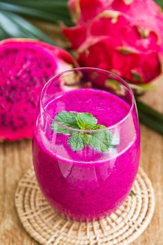 #Dragonfruit smoothie - Blend your dragon fruit with banana, honey, ice and yogurt topped with #pomegranate and mint.