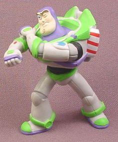 "Disney Toy Story Buzz Lightyear Shooting Arm Laser Pose PVC Figure, 3 1/8"" tall"