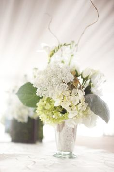 I love flower arrangements in julep cups. Arrangements in monogrammed julep cups for a wedding? So southern, so perfect.