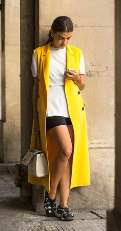 Mellow yellow, Paris Fashion Week, street style, sleeveless coat/Garance Doré
