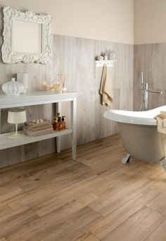 Wood look tile, I love this stuff. This bathroom is cool, old fashioned and modern elements
