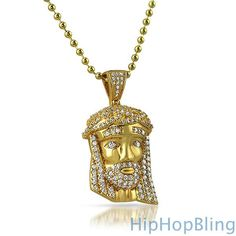 The Micro Jesus Piece pendant is very popular among rappers and celebrities.  This highly detailed small Jesus Face Pendant, is meticulously crafted and iced out in lab created CZ diamonds that bling like the real thing.  All stones are hand set with prongs so it looks and feels legit.  The piece is dipped in 18k gold for a genuine like shine. A free 36 inch small bead hip hop chain is included …