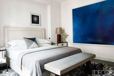 I really like that pop of blue artwork in such a neutral room, it's perfect   14 Gender-Neutral Bedrooms We Love via @MyDomaine