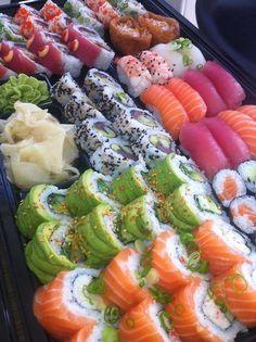 SUSHI. (Well, red dragon, green dragon, tuna and salmon rolls, firehouse rolls, tofu pockets, and salmon, tuna, ebi nigiri). What a tray.