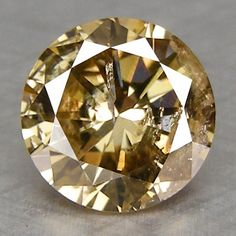 Champagne Diamond from Argyle Mine, Australia.  Champagne, cognac and chocolate diamonds have been heavily marketed since it was discovered that Argyle mine has mostly brown diamonds, which were previously only used for industrial purposes.  It's estimated there are a trillion carats of diamonds yet to be mined there.