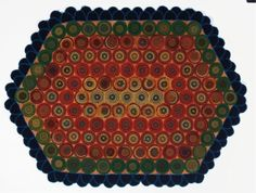 Wool and cotton early 20th century, lozenge-shaped rug composed of multi colored concentric circles of woven and felted wool fabric, backed with vintage paisley textile back 3 ft. x 4 ft.  Look at the close up of this rug, looks as though the red bled through the stitching, another great rug with close blanket stitches from the site Live Auctioneers