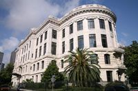 The French Quarter has a unique architectural cohesiveness with its rows of historic 17th and 18th residential houses. One significant exception is the Supreme Court Building, an imposing white granite structure in Beaux-Arts Style
