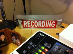 Recording lighted sign.