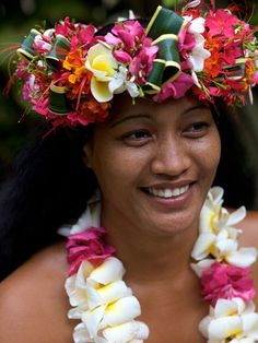 Tahitian woman with floral head dress and lei