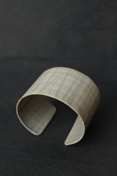 Sycamore wood cuff. May Furniture Co.