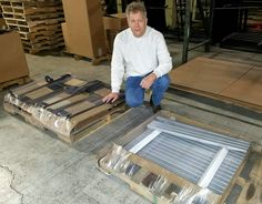 HTS Systems' Carl Boettcher with HTS Ultra-Rack parts from Metal Integrity and Custom Powder Coating.