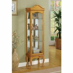 """Coaster 950194 Oak Finish Wood Curio Cabinet with Glass Sides And Door by Coaster Home Furnishings. $255.13. Glass panel door. Traditionally style. Shapely arched top with simple moldings. Made from wood veneers and solids. Lifted on four shapely legs. Oak finish wood curio cabinet with glass sides and door. Cabinet measures 15 3/4"""" x 11 3/4"""" x 64"""" H.Some Assembly may be required.. Save 51% Off!"""