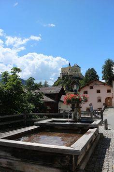 Beautiful swiss castle Tarasp in Grisons. Schweizer Schloss in Graubünden. Switzerland travel tips.