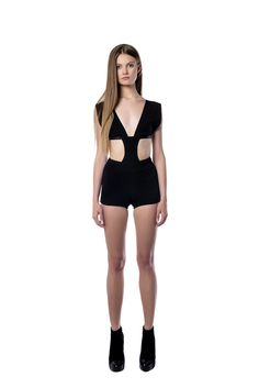 Slim fit black playsuit   This slim fit playsuit is cut with an alluring open back and crafted from black crepe. The deep neckline and the side cutouts of the design highlight your silhouette. We best like it with platforms and statement accessories.