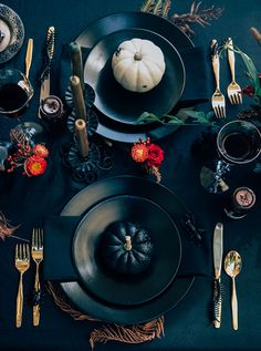 Make your Halloween dinner table ultra festive with black accents + fake bugs.