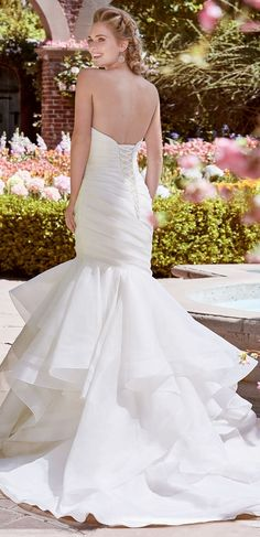 Rebecca Ingram - PATSY, Made with Tuscan Organza, this asymmetrically pleated mermaid wedding dress features a unique sweetheart neckline and a tiered fit-and-flare skirt trimmed in horsehair.