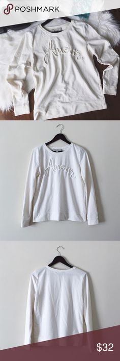 """•Loft Amour Crew Neck Sweatshirt• Loft white crew neck sweatshirt with amour written on the front with rope detail. Excellent to wear to the beach or around the fire. Worn a few times, great condition.   •color: white •size: medium  •graphic sweatshirt """"amour"""" •crew neck    Approx Measurements (laying flat):       •length: 24.5in  •No trades(comments will politely be ignored). •15% off 2+ items 💕 LOFT Tops Sweatshirts & Hoodies"""