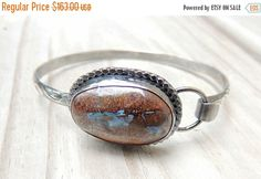 A personal favorite from my Etsy shop https://www.etsy.com/listing/454397132/on-sale-20-off-silver-bolder-opal-bangle