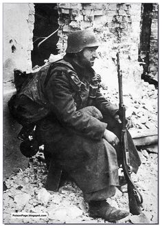A German soldier rests at Stalingrad. 1942.  It's always great to find photos from Stalingrad that I've never seen before. Prima!