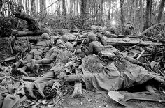 Dac To, South Vietnam -- 11/22/67: Members of the 173rd Airborne Brigade are engaged in a long, long crawl to the crest of Hill 875, a steep mound that in four days has cost American forces some of their highest casualties of the war. Pushing inch-by-inch of sloping earth behind them, U.S. paratroopers seized most of the hill Nov. 22. They are now faced with a North Vietnamese stronghold atop the peak and reports of two fresh regiments of NVA troops moving into the region.