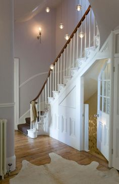 I would change the lighting, but that staircase is GORGEOUS!