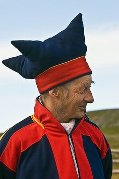 Sami man in traditional dress with cap of the four winds; Norway, Kirkenes