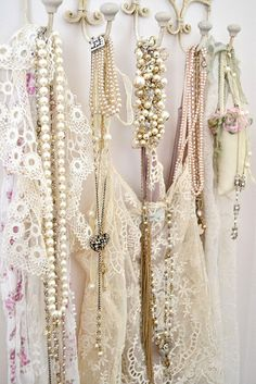 hang necklaces off pretty hooks.  This is what I do...then I can look at sparkles when I'm not wearing them:))