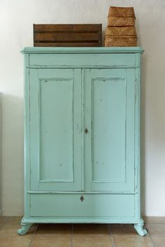 Gorgeous aqua cabinet.
