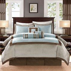 Exude a tranquil atmosphere in your bedroom with this classy comforter set. It includes a comforter, bedskirt, two shams, and three pillows, all made with polyester dupioni fabric for added softness. The setÍs solid design complements various room decors.